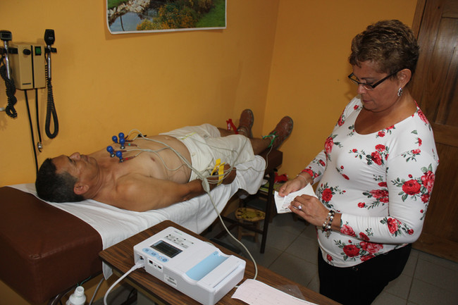 Introducing our new 2019 EKG machine as Cardiologist gives Day Guard, Pastor Manuel Mesa a quick heart exam