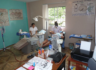 Bird's eye view of dental clinic. Dra. Karolina takes a quick break and hygientist Carol trudges onward