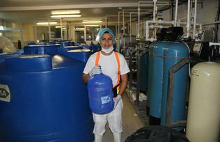 Jorge with 20 liter bottle