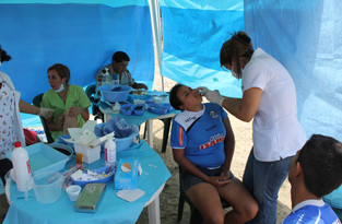 Medical/Dental mission to the local dump brought many. This makehift 'dental office' was great!
