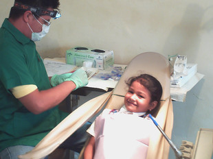 "During ""Dental Awareness Week"" students and teachers were examined gratis. This young lady never stopped smiling"