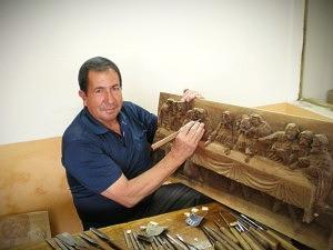 Ecuadorian artisan in San Antonio displays his work and tools in his home