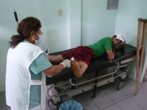 Nurse Assistant Angelita cleanses newly amputated patient