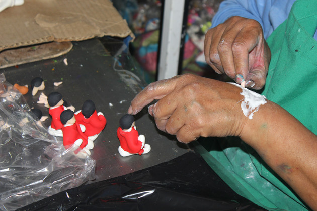 Rosa Perez's family business shows delicate work in creating the shepherd boy for a nativity.