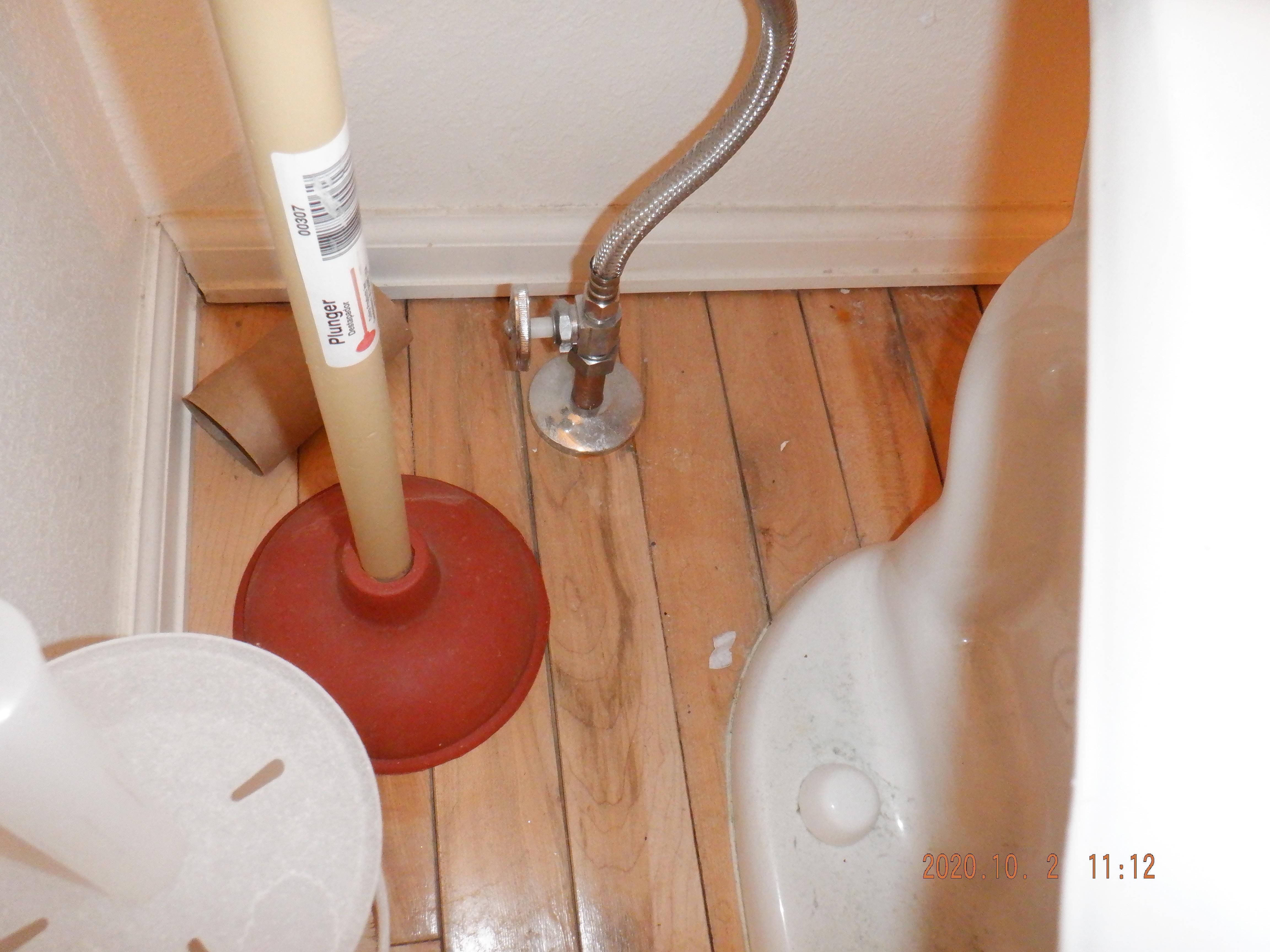 Behind toilet