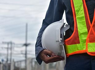 engineer-holding-hard-hat-safety-work-pl
