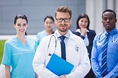 team-of-doctors-standing-together-in-hos
