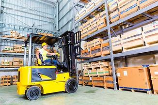 asian-fork-lift-truck-driver-lifting-pal