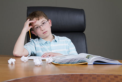 image of child with learning disability sitting at a desk