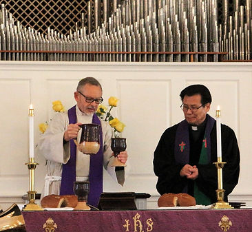 Rev Kurtz and Rev Kim perform Communion