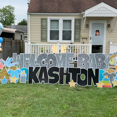 Baby shower yard signs and balloons.