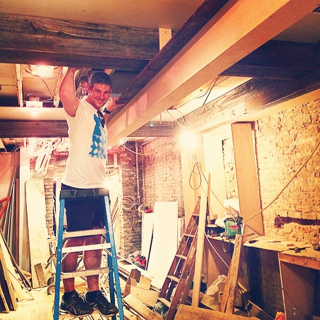 Owner, Derek Walsh hanging new beam