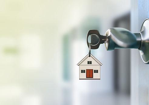 Open door with keys in keyhole.jpg