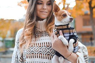 woman and small dog in matching sweaters