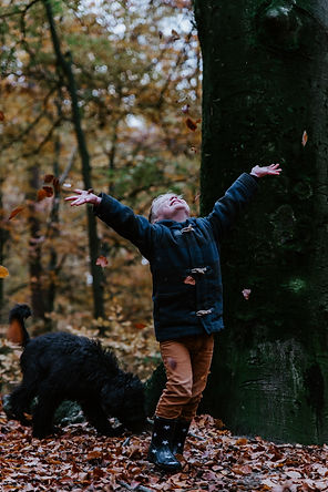 kid and dog in fall leaves.jpg