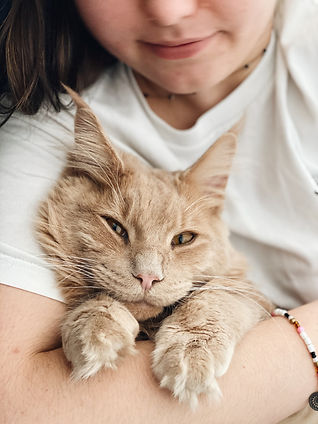 girl with cat in arms.jpg