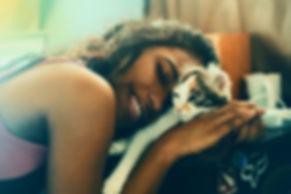 woman cuddling calico.jpg