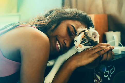 woman cuddling calico.jpg