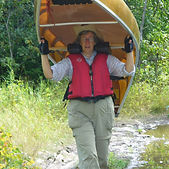 Barb carrying a canoe upstream