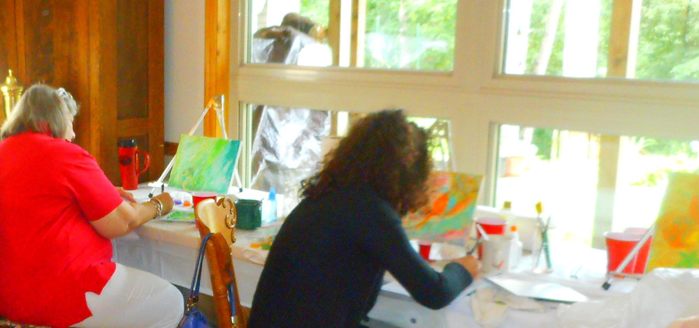 Participants journaling and painting
