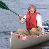 Barb paddling a canoe