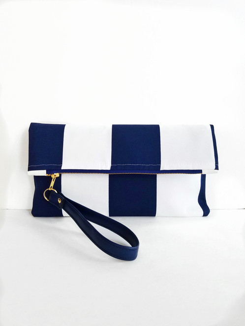 95470239dc This Nautical Stripe clutch is part of our Nautical collection. Her large  navy and white stripes are bold and chic! She is a classic print that never  fades!