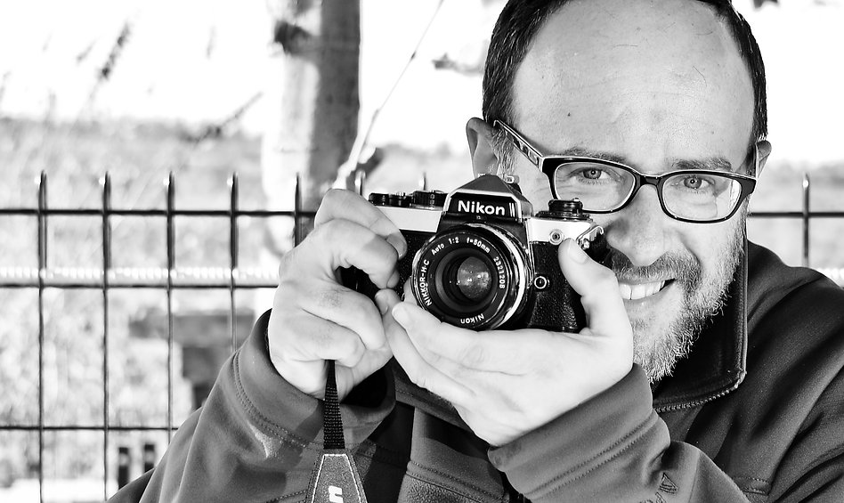 Mordechai Gordon with 1986 Nikon FE2 film camera