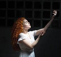 woman-wearing-white-dress-raising-her-ha
