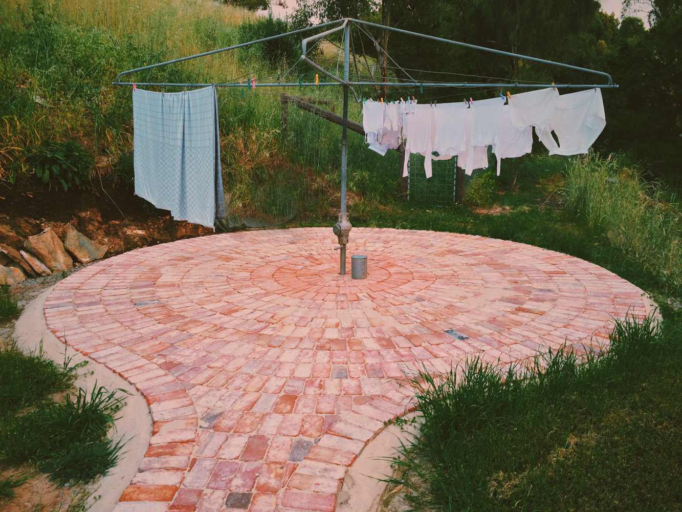 Old red brick clothesline pavement