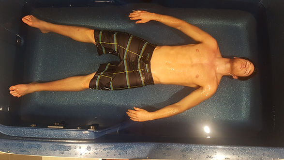 Guy floating in sydney float tank