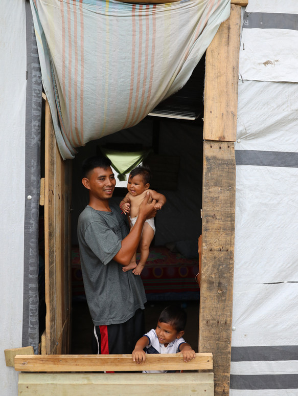 Chamalecón, San Pedro Sula, Honduras.   Jose, his new born girl, and three year old boy.