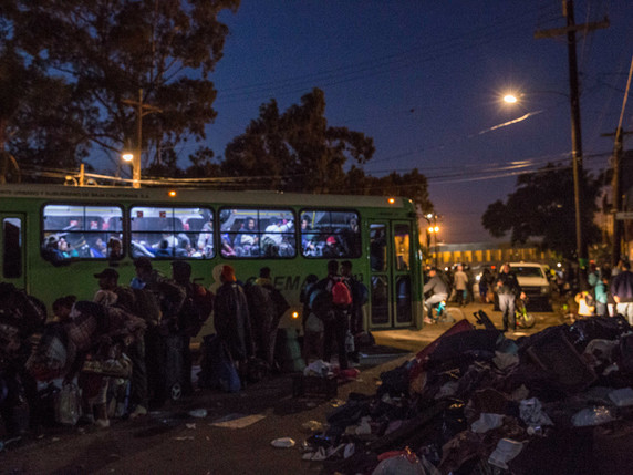 Hundreds of Central American migants are bused to a new shelter by the Mexican government.