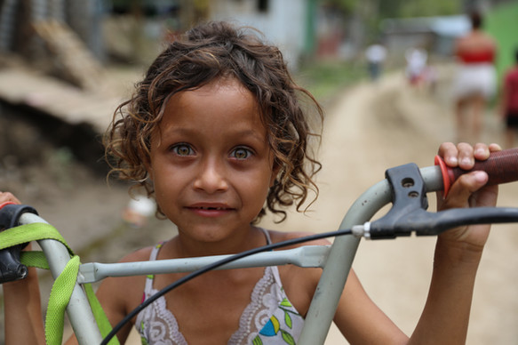 Chamalecón, San Pedro Sula, Honduras.   Brenda and Franklin's daughter Katherine opens her eyes wide to show off her deep green eyes.