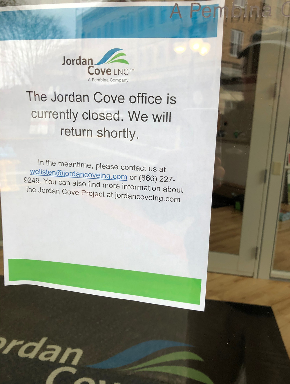 A sign in the window at Jordan Cove's office in Coos Bay.