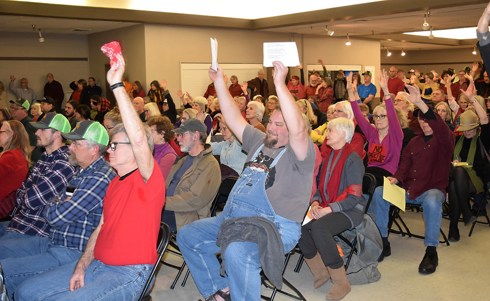 Citizens attend one of five hearings on the removal-fill permit for Jordan Cove hosted by the Oregon Department of State Lands.