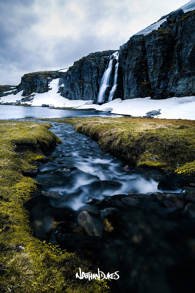 Flotvatnet lake Norway with stream and waterfall long exposure landscape photography by Nathan Dukes Art