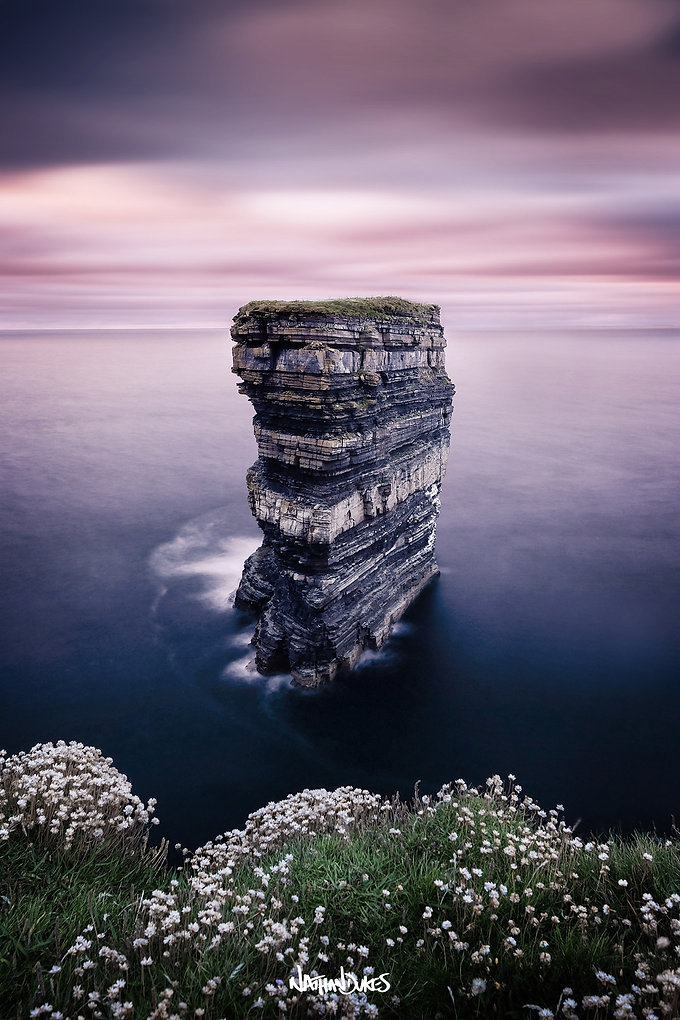 Dramatic purple sunset at Downpatrick Head County Mayo Ireland landscape photography by Nathan Dukes Art