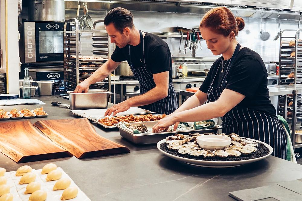 kitchen employees preparing food trays