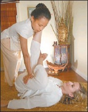 Neata Auttapong demonstrates her mastery of the massage at the new Thai Spa.