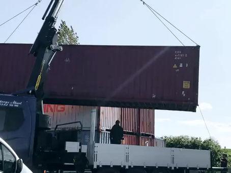 Flytt av den första containern