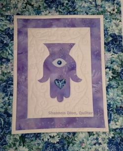 purple hamsa.png