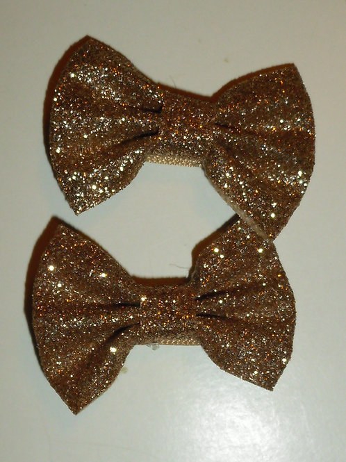 Faded Glory 2 barrettes bow/gold sparkle