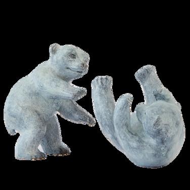 Polar bear cubs. Sculpture.