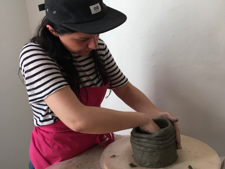Coiling clay to perfection.