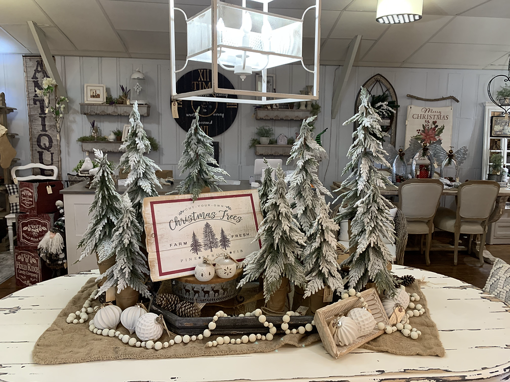 A cozy, rustic Christmas table setting at The Market Station in League City.