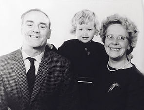Old black and white photo of Betty and Bob Elley with their daughter, Sharon