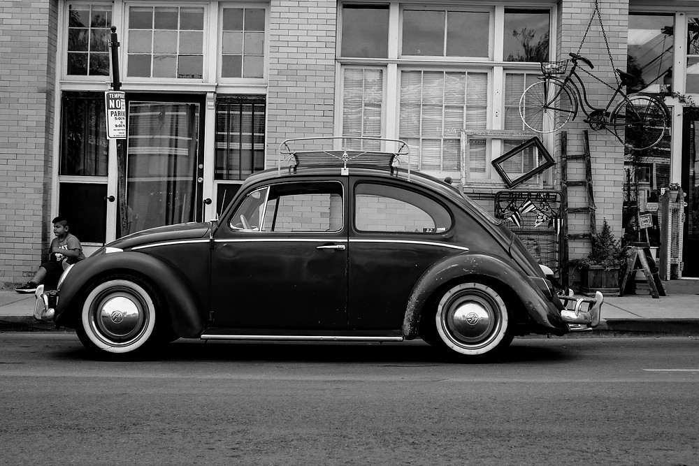 Antique Volkwagon Beattle with black and white filter