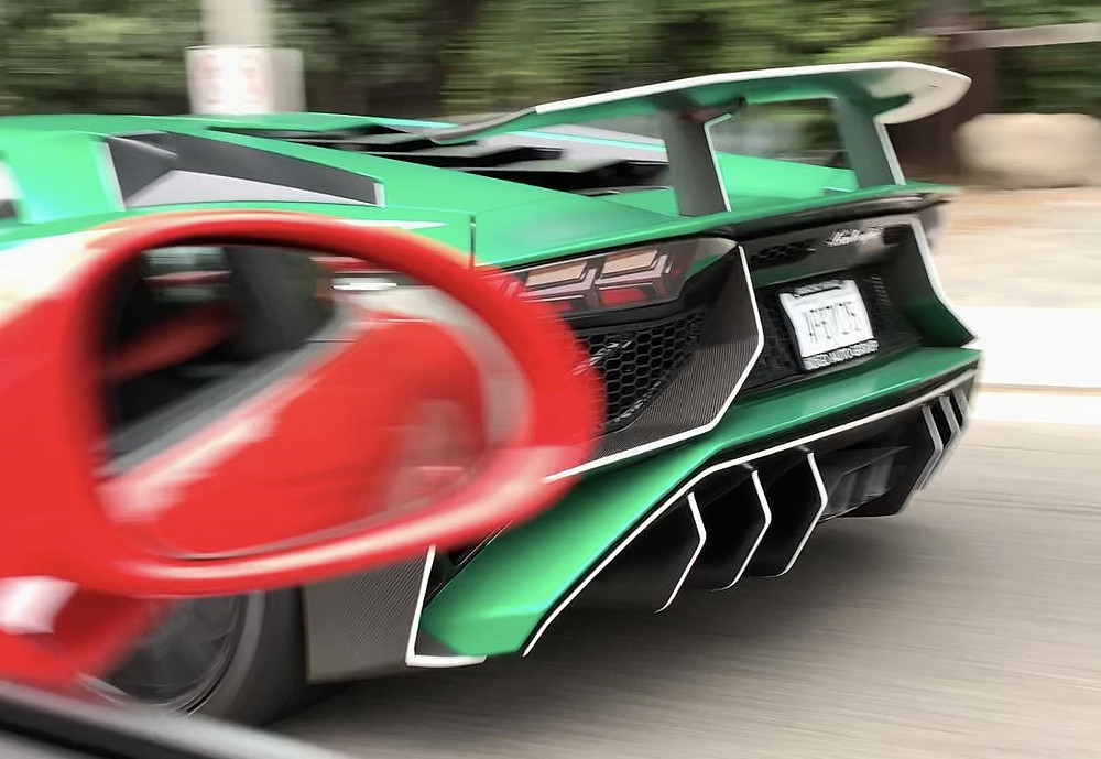 Red Porshe GT3 and Green Aventador SV
