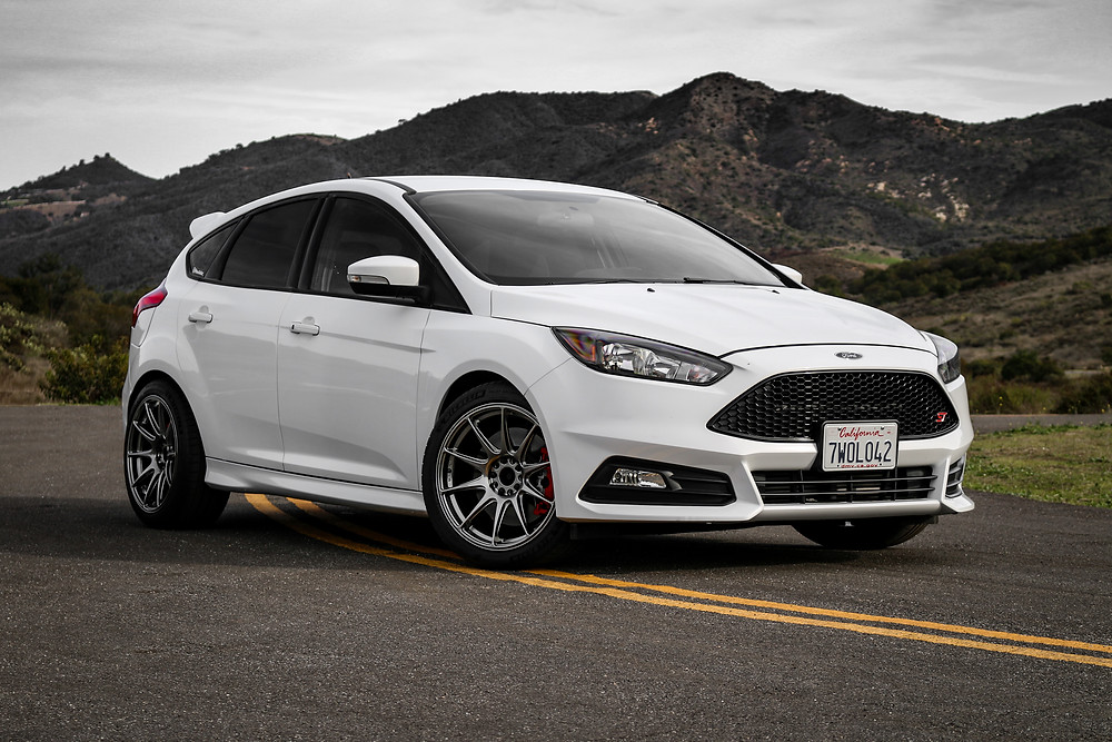 White Side Profile Ford Focus ST, Mountain Scenic Background - less is more