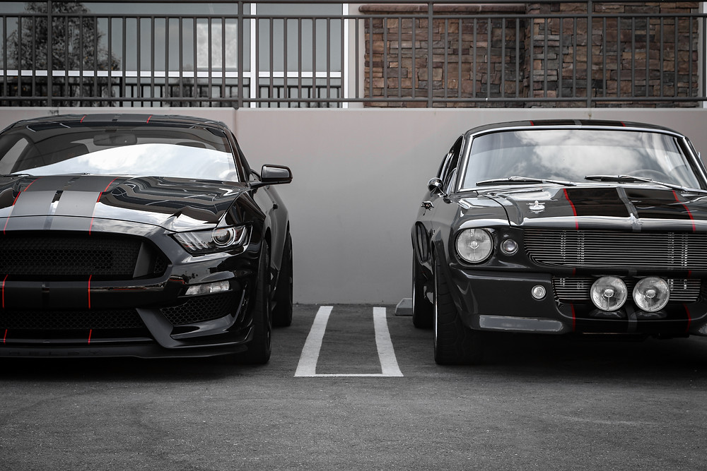Black and Red, New and Old Generation Ford Mustangs - editing